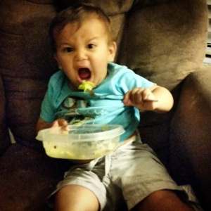 Guess the food's good because he's demolishing it.